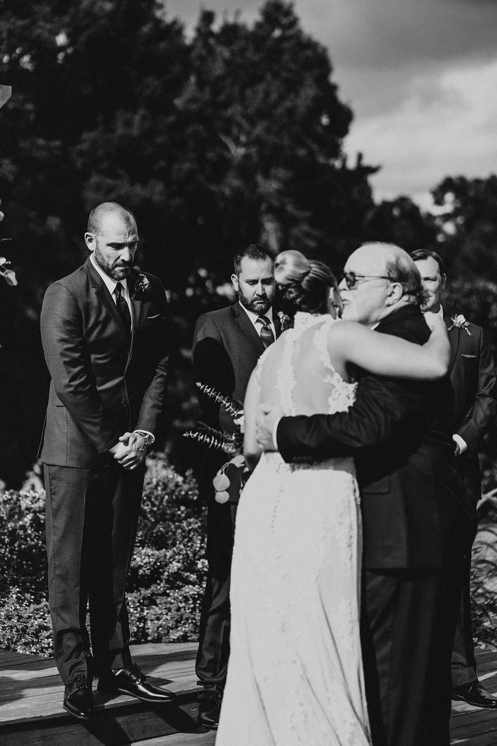 black and white photo of father and bride at the ceremony in a vineyard