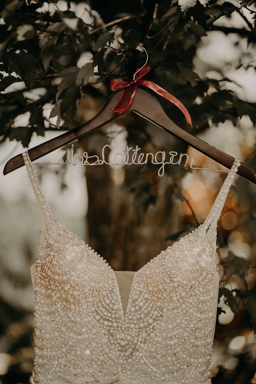 gorgeous wedding dress in a hanger