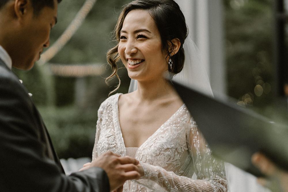 Asian bride smiling at groom