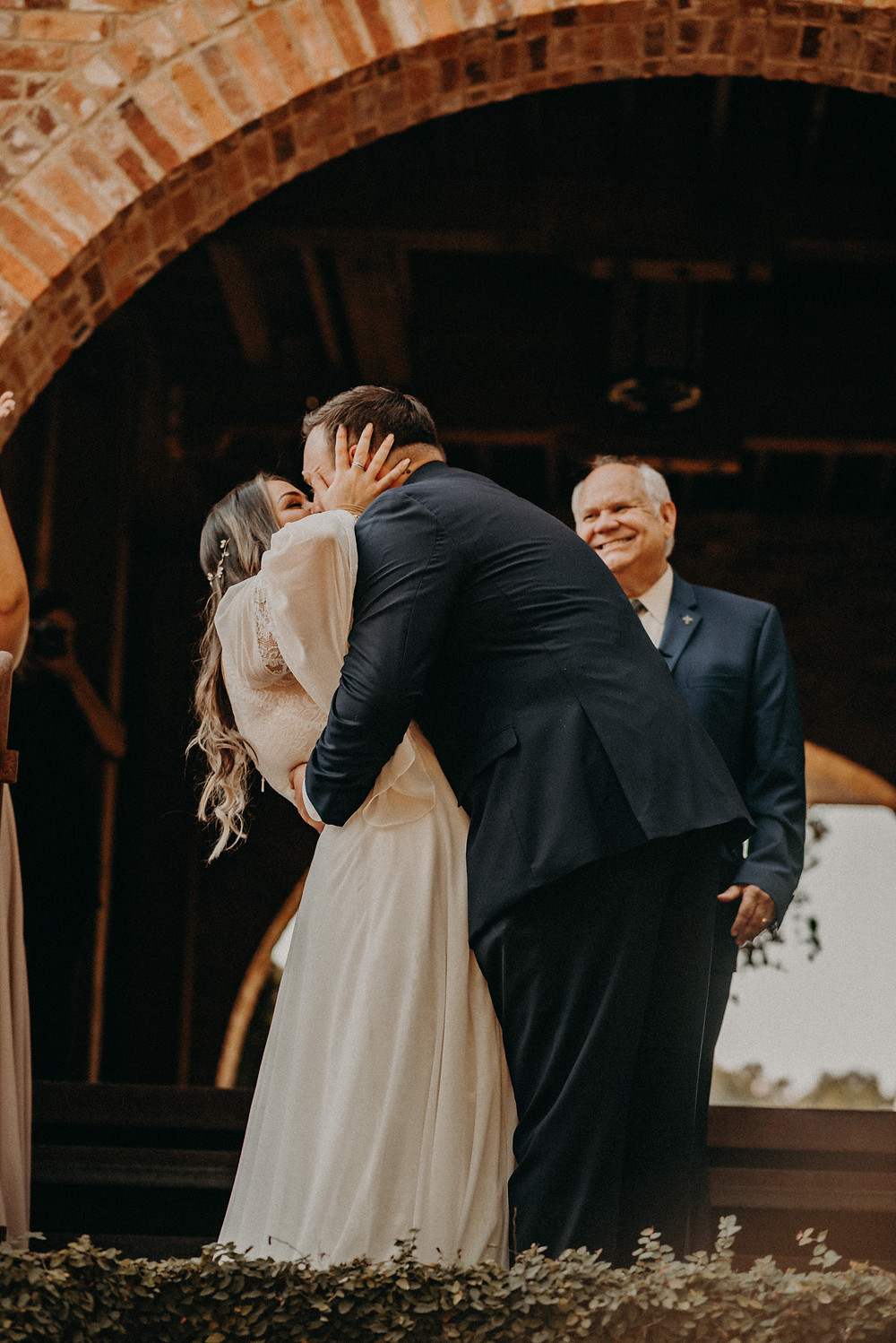 Couple kissing at their wedding ceremony at Cherry Hollow Farm, GA