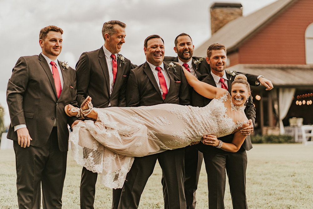 groomsmen holding the bride