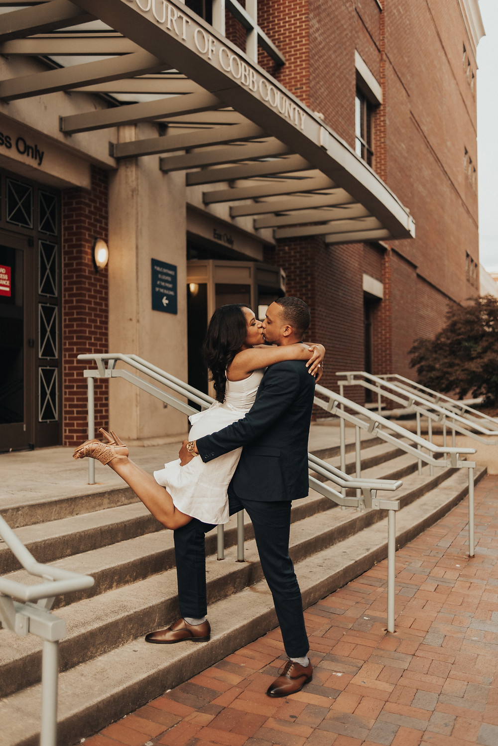 Couple kissing in their engagement session