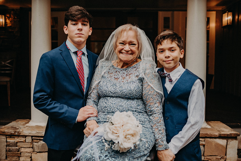 Elder bride with her grandsons at her wedding