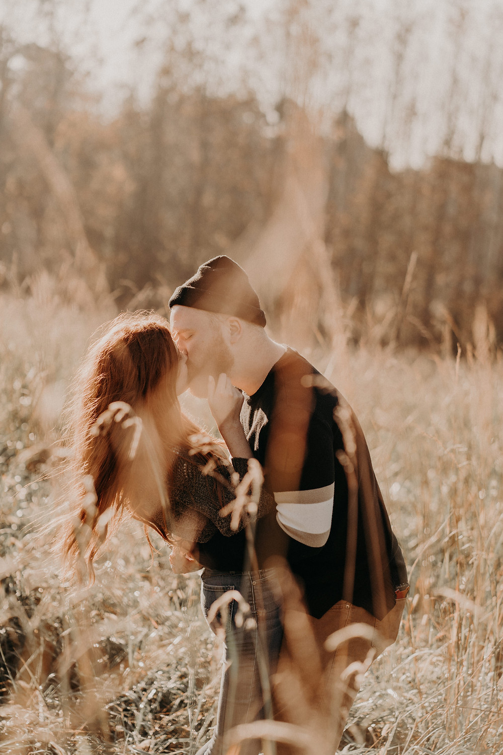 ginger couple hugging in a field