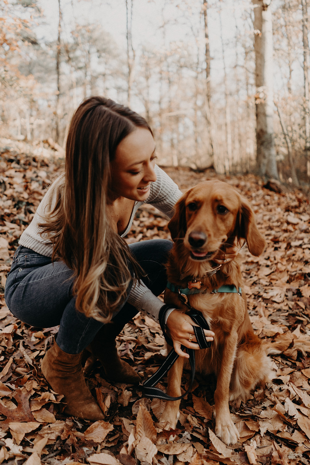 woman playing with her dog in a fall photo session