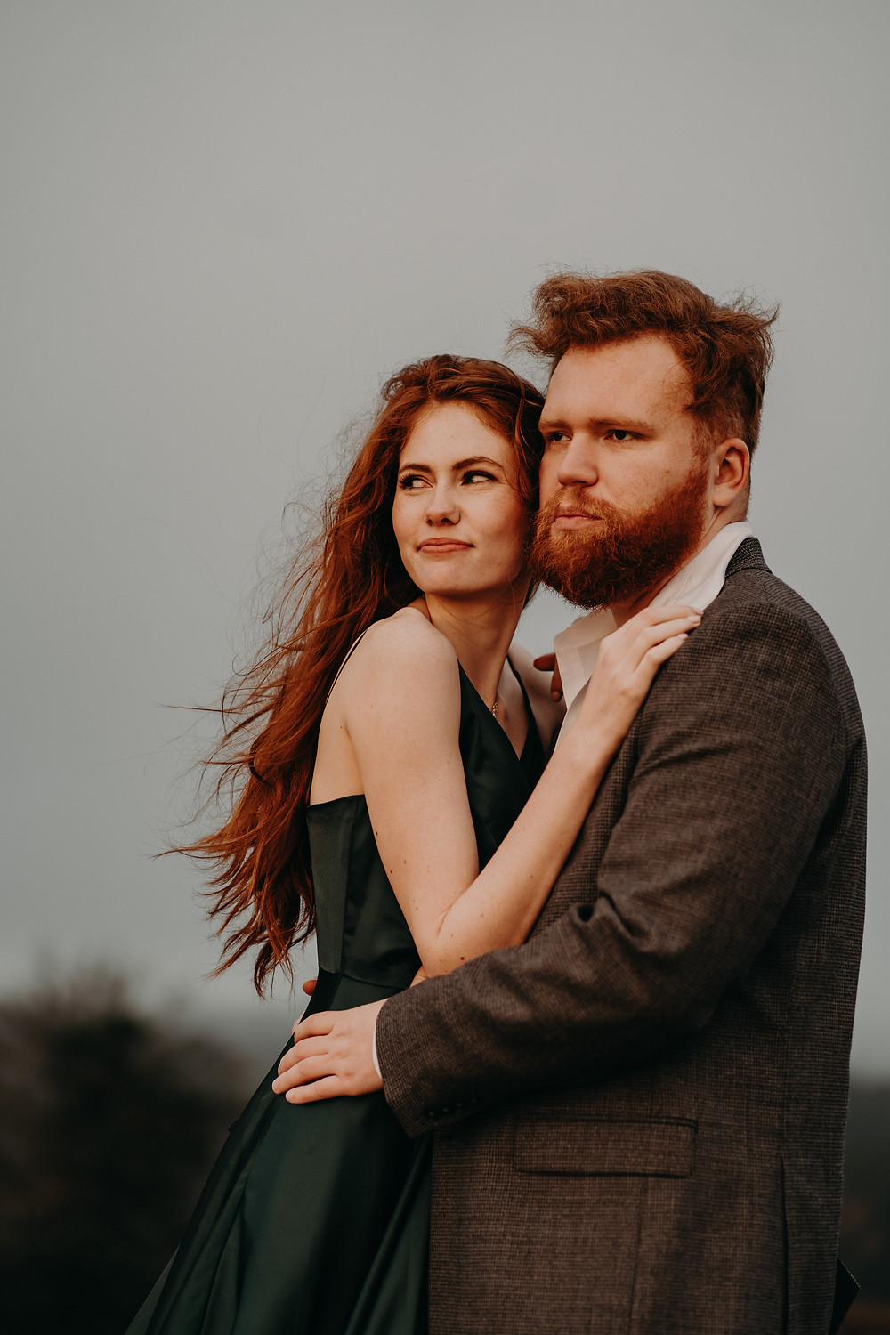 Scottish inspired engagement photography. Scotland red-haired couple wearing formal clothes for their engagement session at arabia mountain