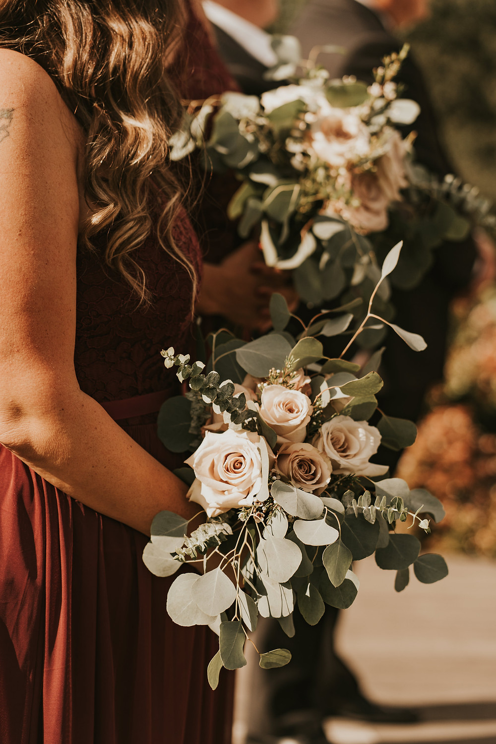 bridesmaid holding a bouquet at the wedding ceremony