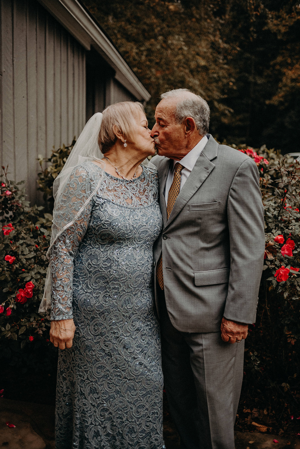 Elderly couple kissing at their wedding