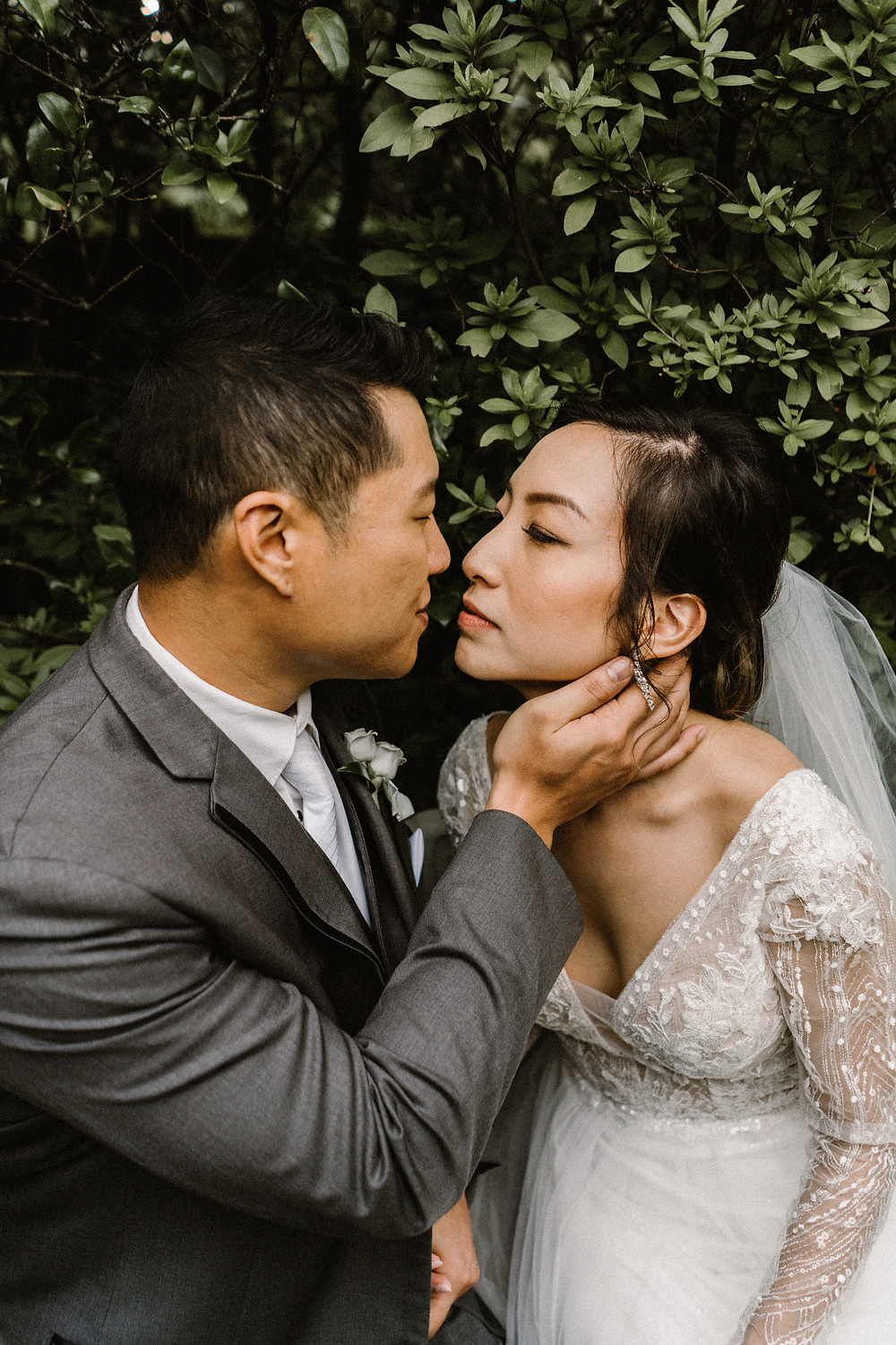 asian couple kissing in a garden. Bride and Groom