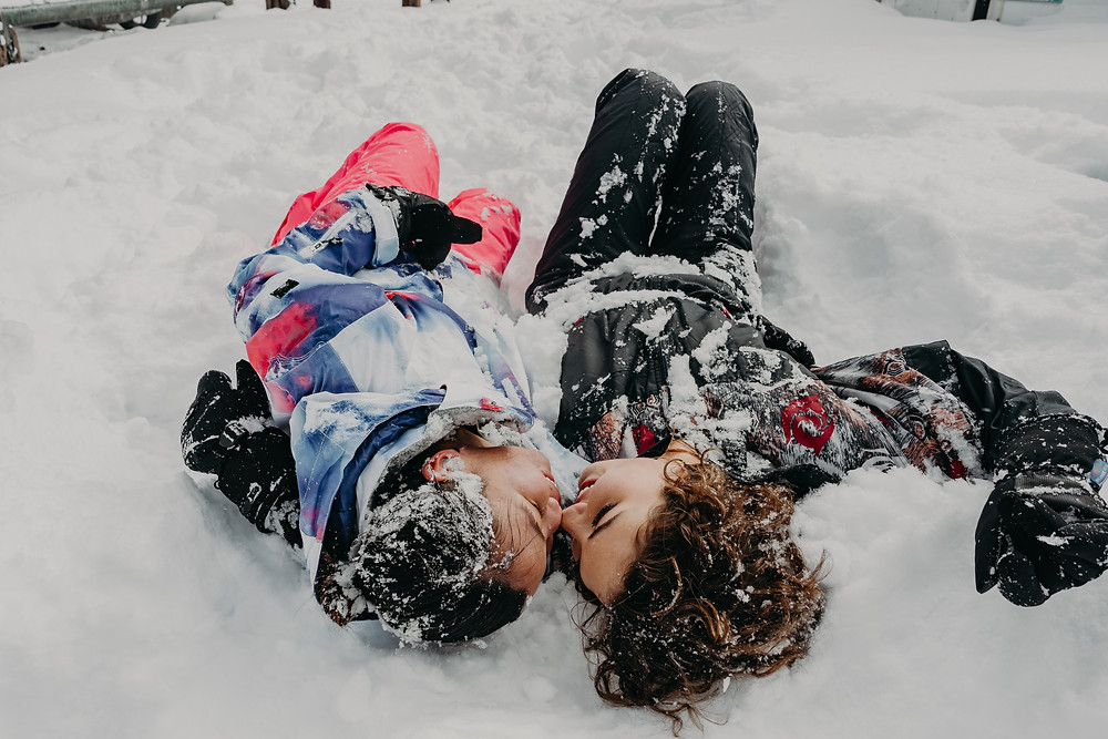 couple laying in the snow