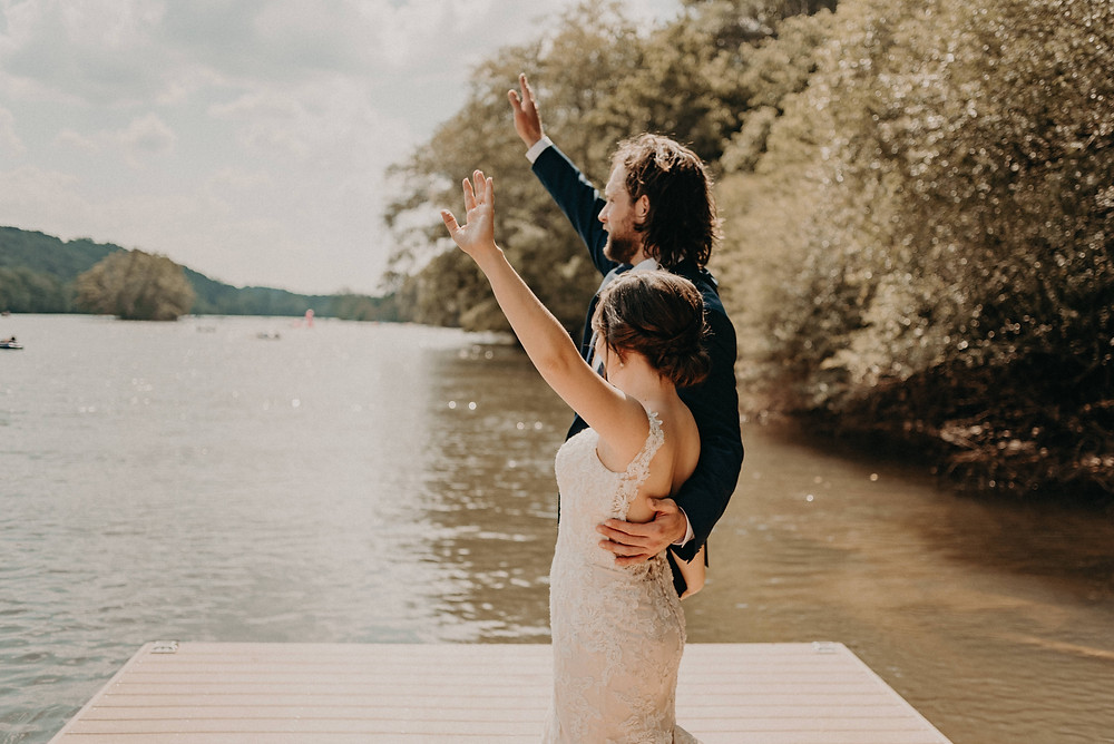 Couple waving by the river