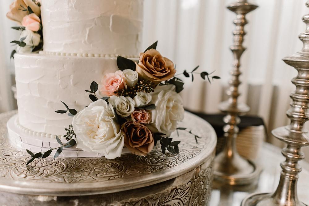 elegant white wedding cake with flower decorations