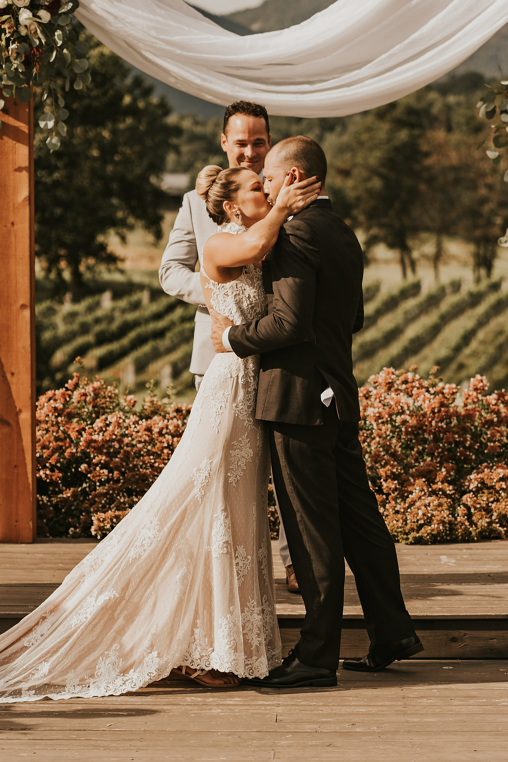 wedding ceremony in a vineyard. Bride and Groom kissing