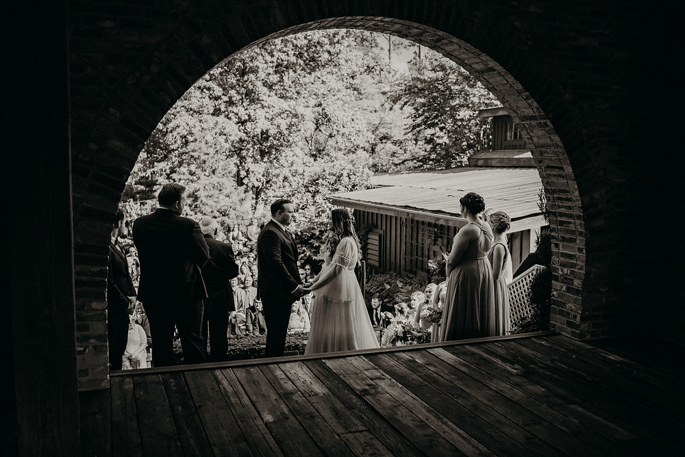 Black and White photo of wedding ceremony at Cherry Hollow Farm, GA