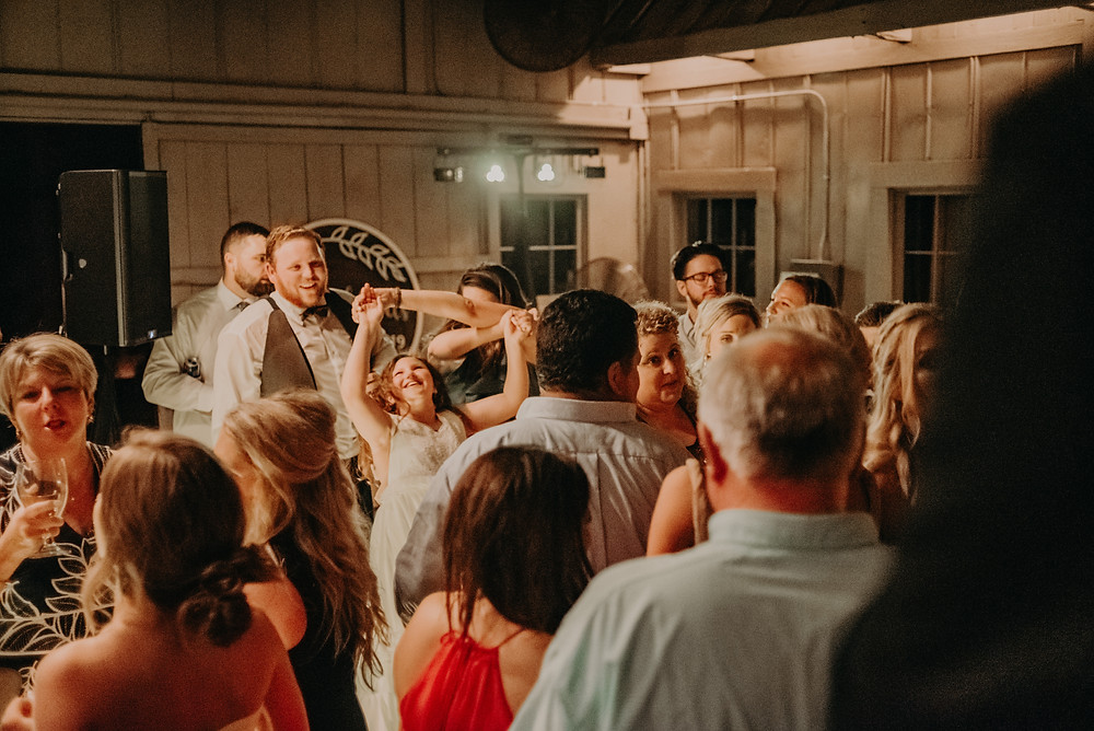 Guests having fun and dancing at wedding reception at Cherry Hollow Farm, GA