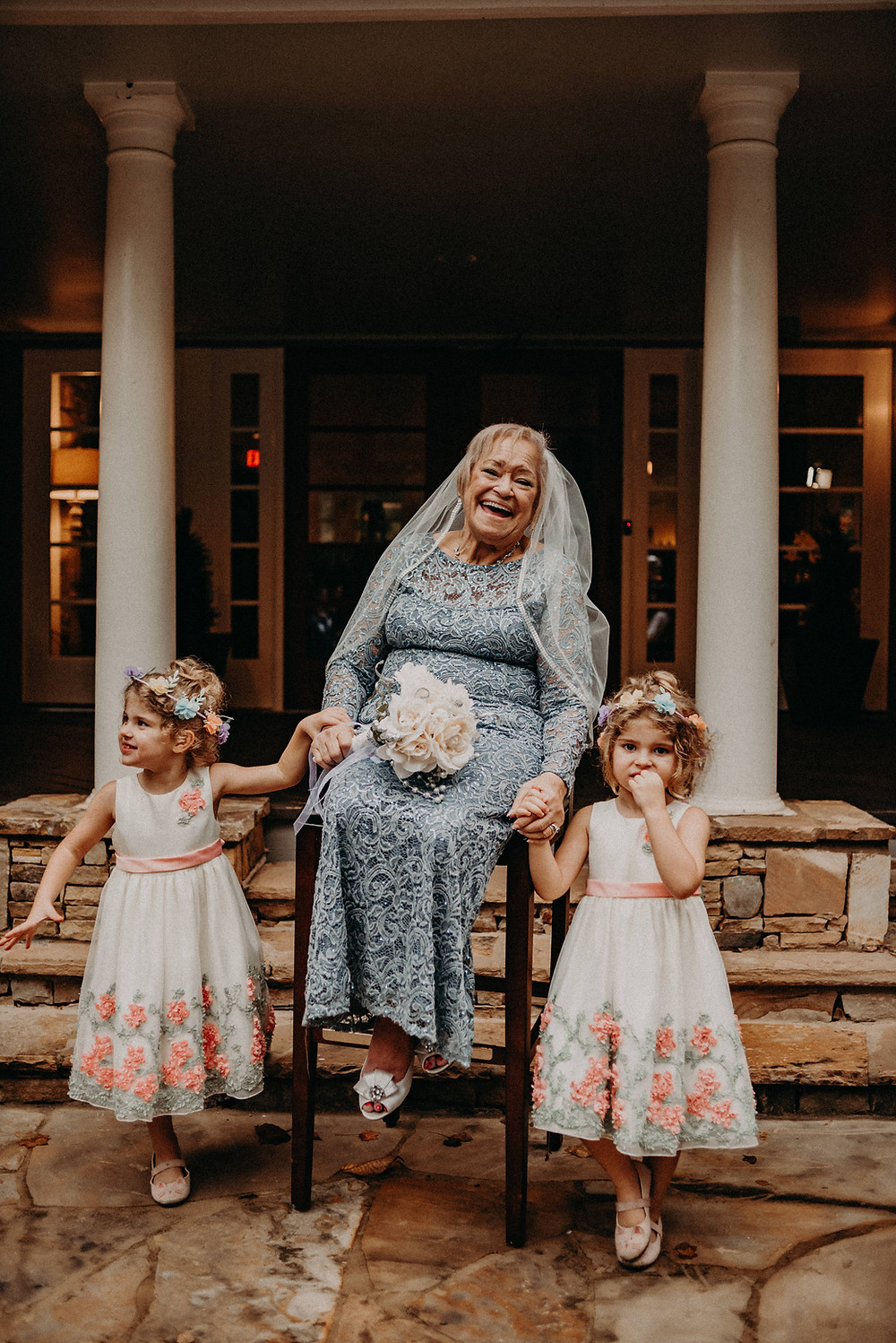 Elder bride with her two flower girls