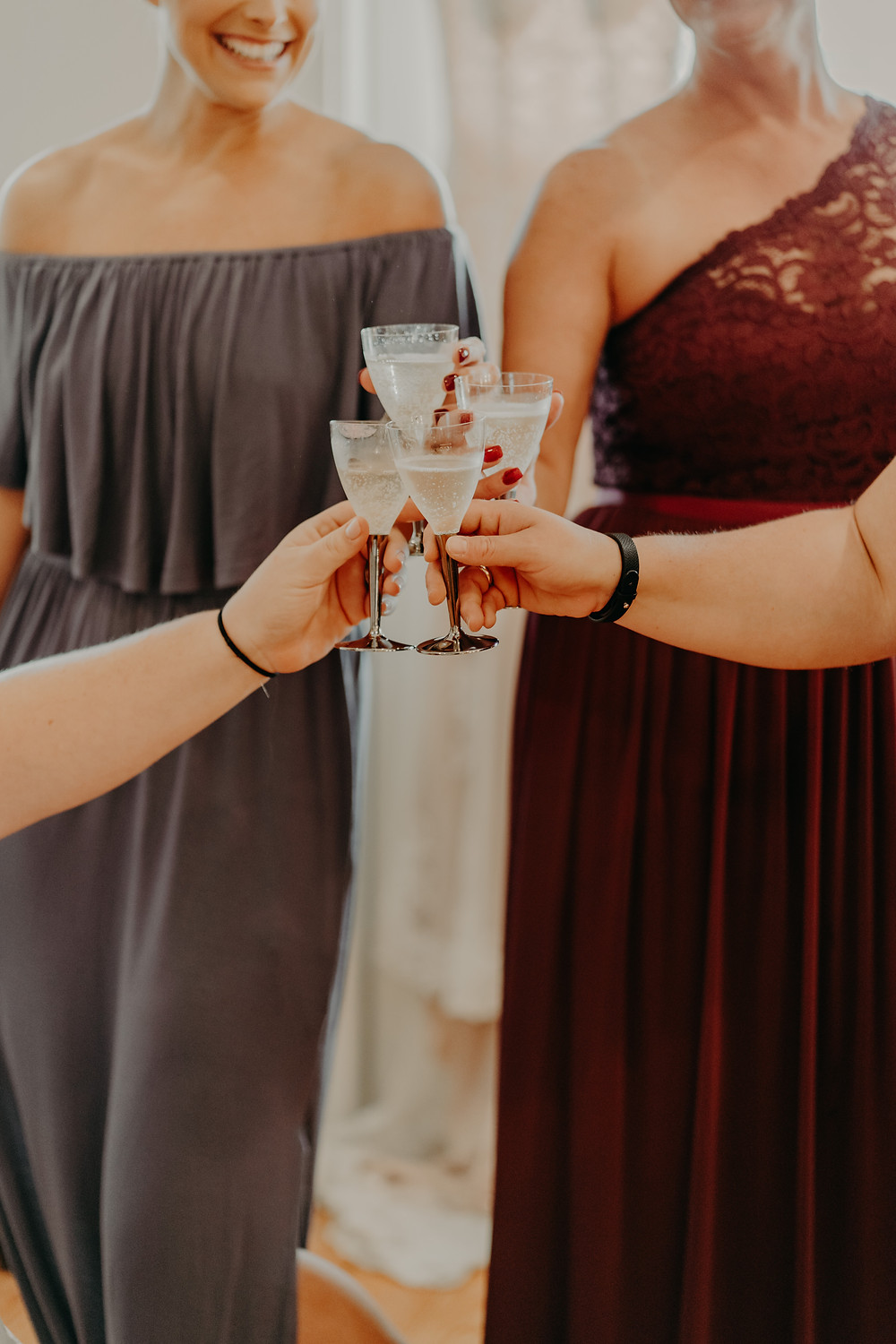 bride drinking with her bridesmaids