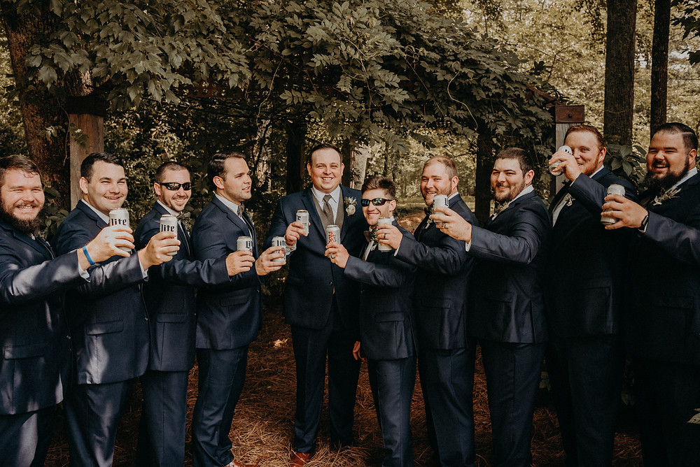Groom with his groomsmen raising a toast