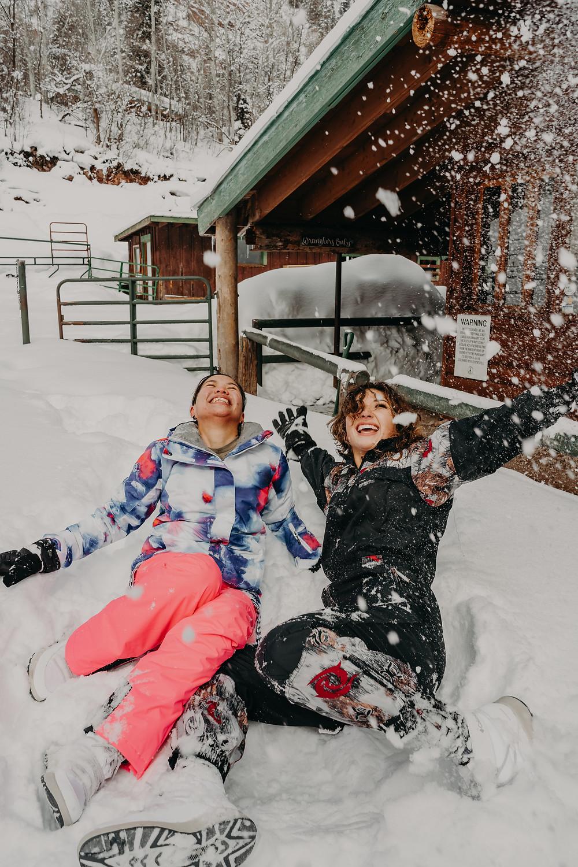 lgbtqi+ couple having fun in the snow