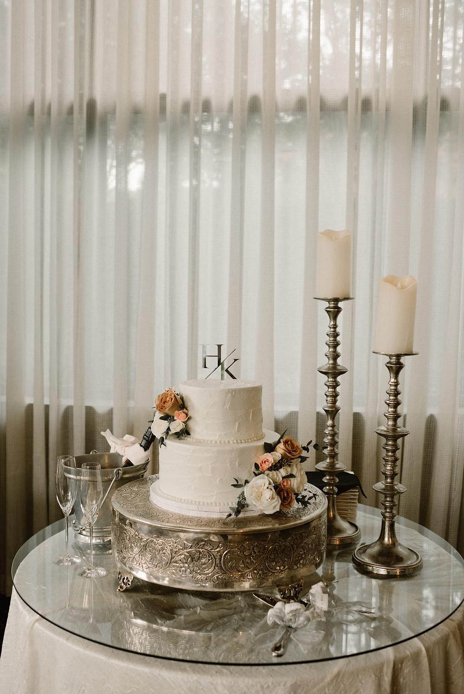 elegant white wedding cake with candle decorations