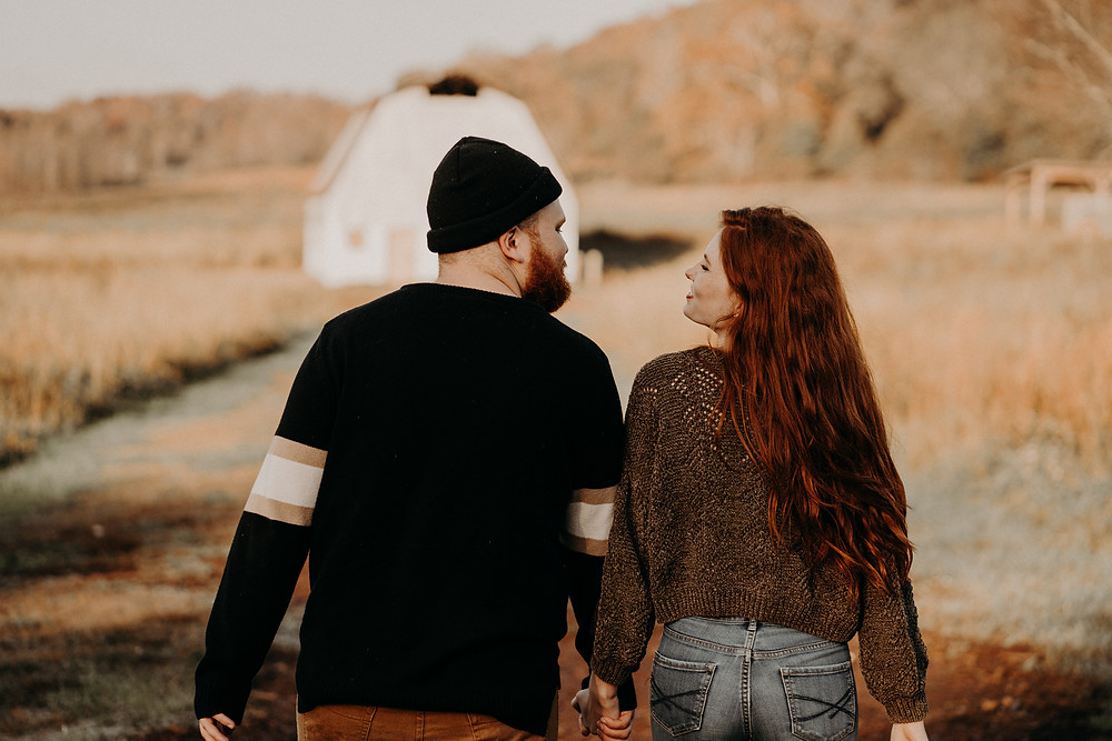 red-haired couple wearing fall clothes