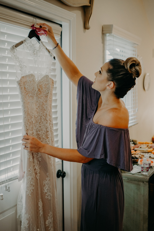 bride getting her wedding dress