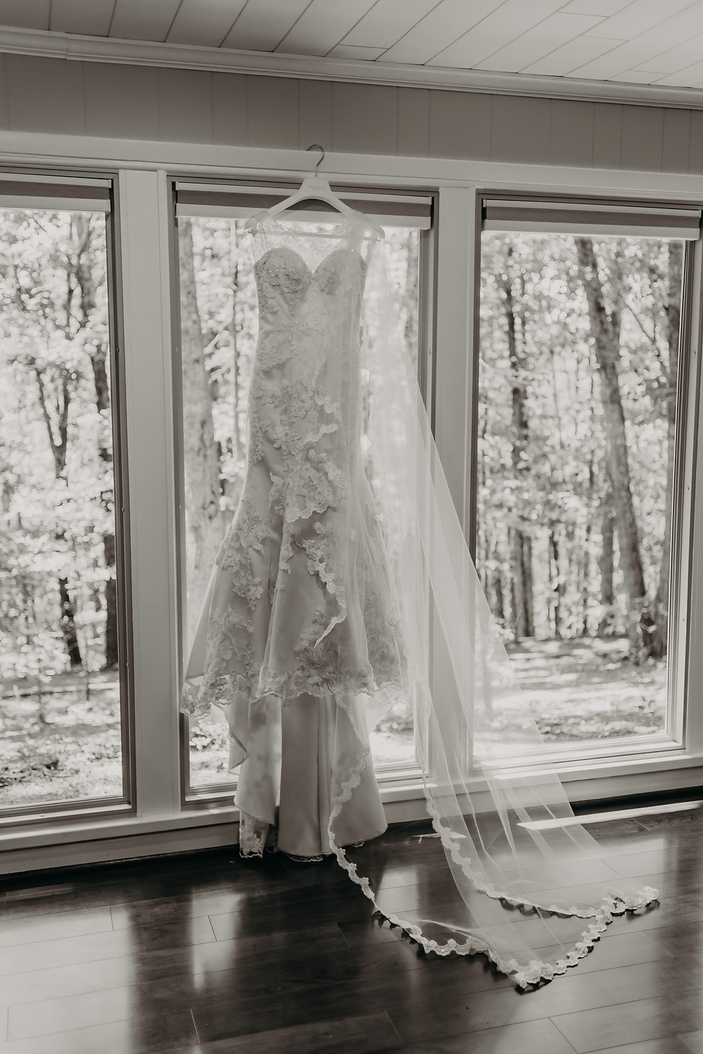 Black and white photo of a lace wedding dress