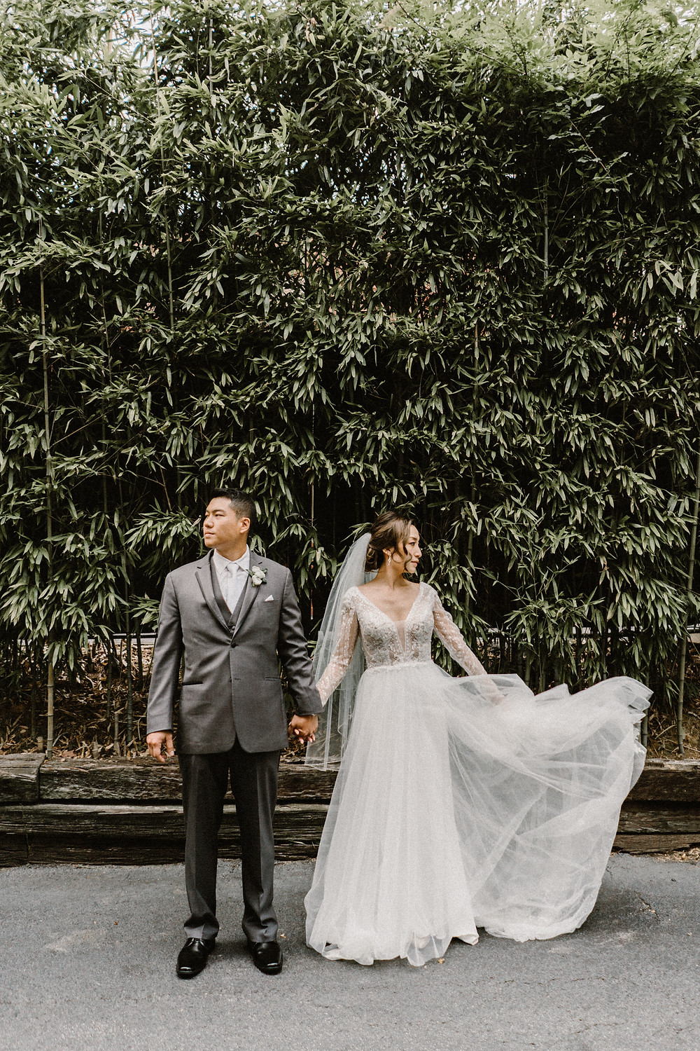 groom in a gray suit and bride in a tulle dress