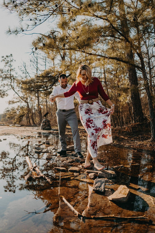 Couple walking barefoot on waterfall