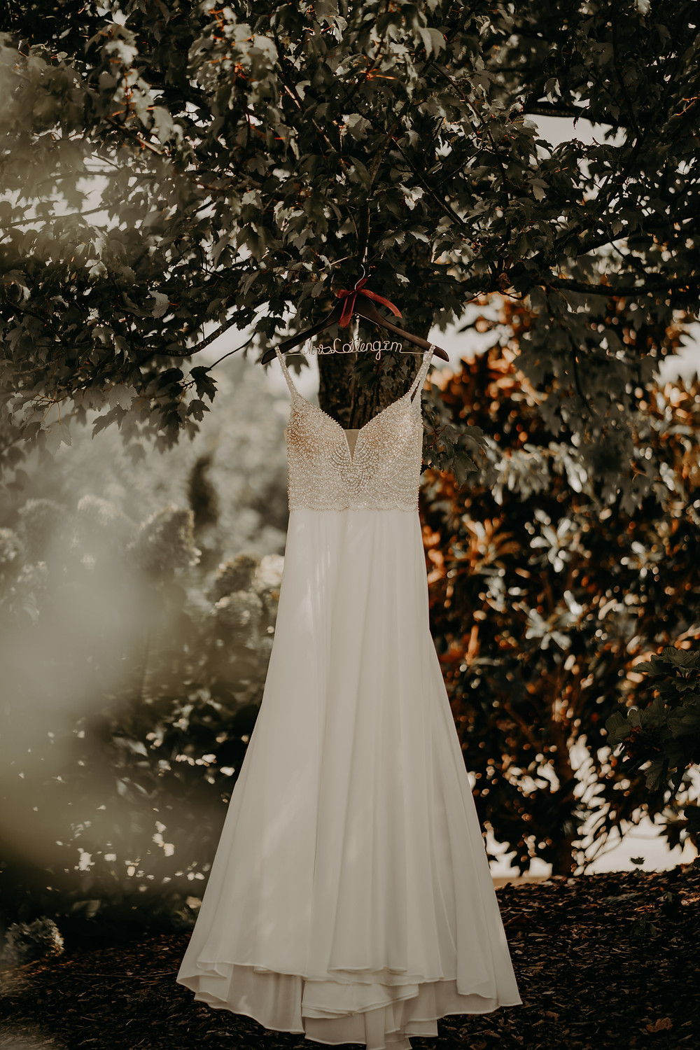 white wedding dress with stones in a hanger