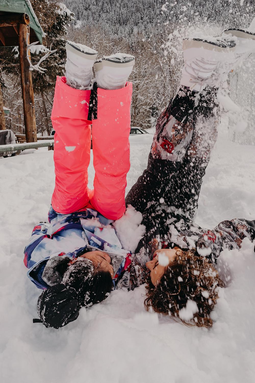 lesbian couple having fun in the snow