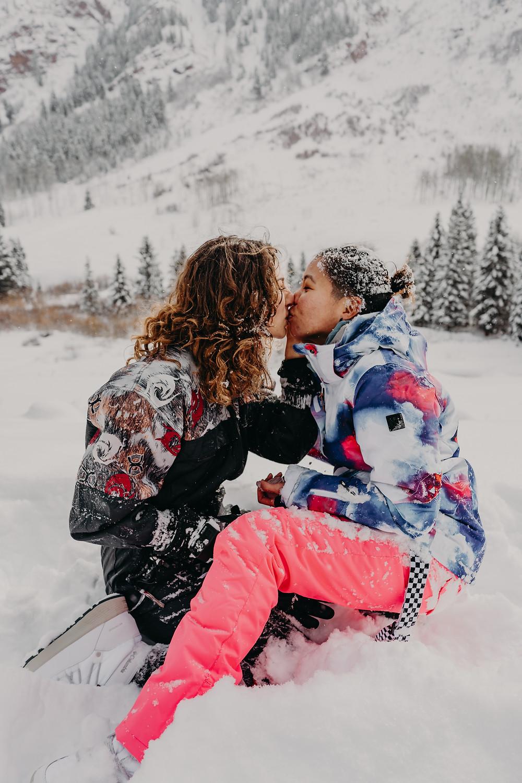 lesbian couple kissing in the snow colorado aspen