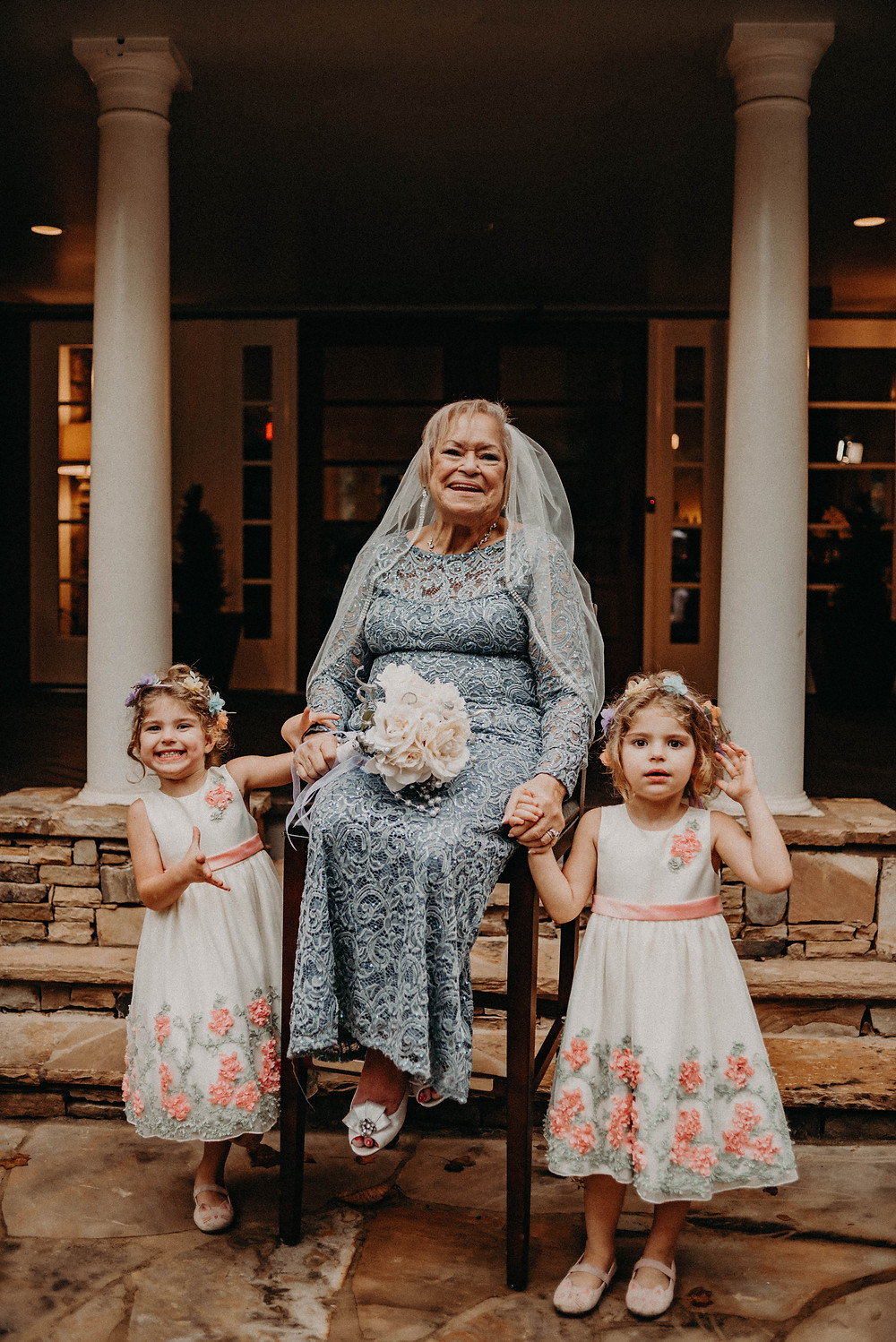 Elder bride with her two grandaughters at her wedding