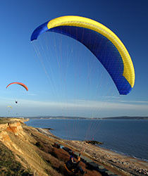 Paragliders at Barton on Sea cliff top
