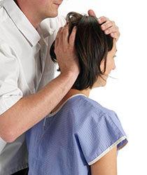 McTimoney chiropractor making a head adjustment