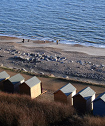 Beach huts at nearby Barton on Sea