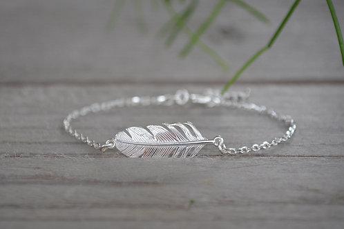 Silberarmkette mit versch. Silbermotiven