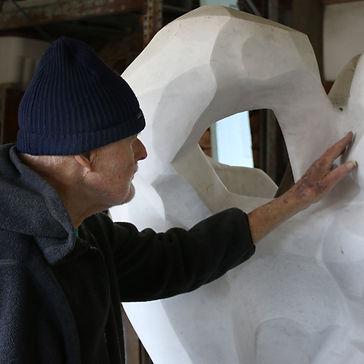 Hank Nelson inspecting marble