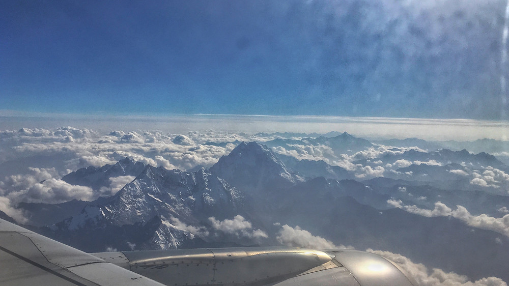 Clouds, mountain, plane wing