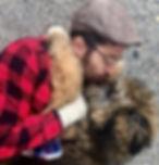 Man kissing puppy