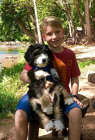 Boy holding puppy