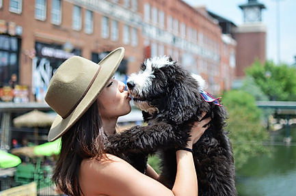 Lady kissing puppy