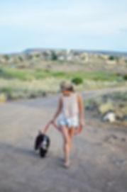 Lady walking puppy