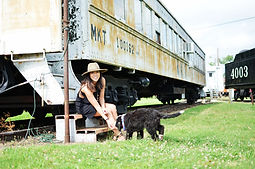 Lady and puppy by train