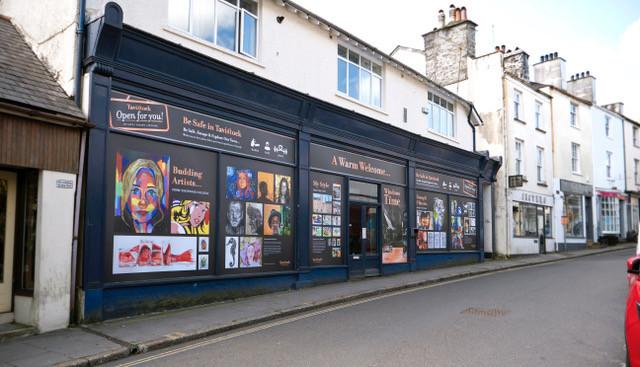 Tavistock billboard vinyls on the front of closed businesses.
