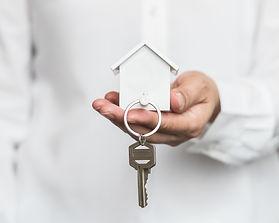 House key in home insurance broker agent