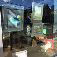 paintings in gallery window