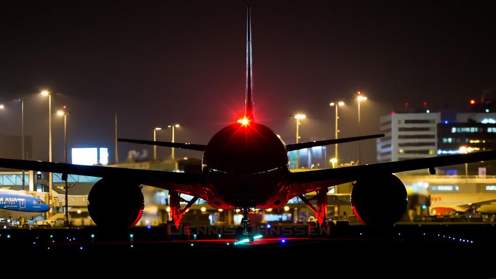 777 at night at Schiphol Airport