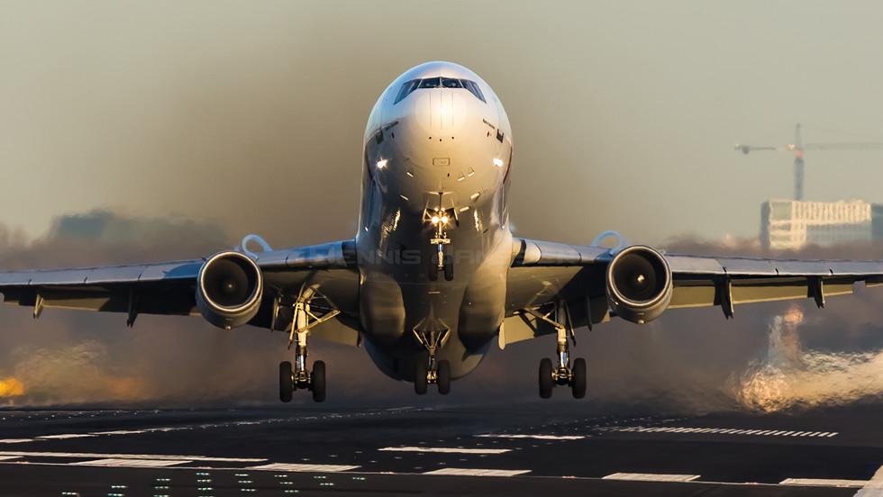 Martinair take-off during amazing sunset
