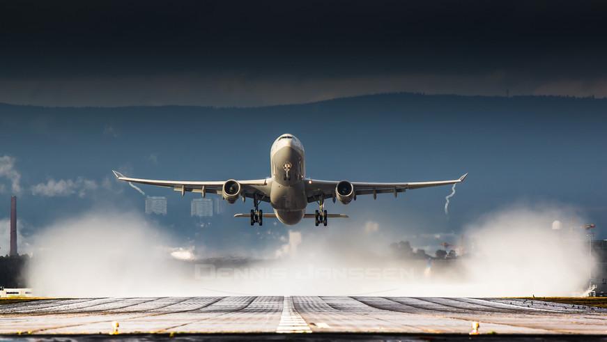 Lufthansa take-off after rainstorm